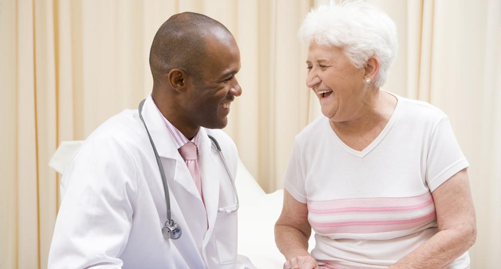 Doctor happy older woman